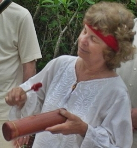 Playing wooden tube at ceremony, Lol Be, Yucatan