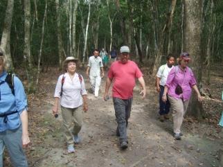 Walking on sacbe at El Mirador with archeologist Ed Barnhart (red shirt)