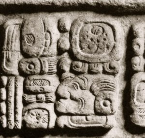 Mayan hieroglyph carved on monument.